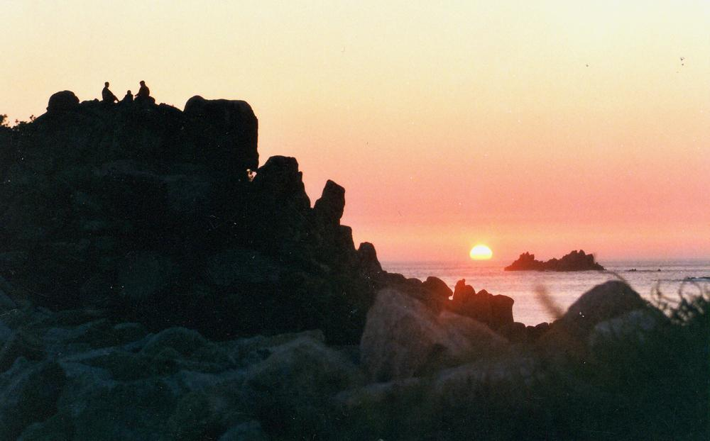 Drink in the sun. Watching the ocean sunset over the Western Rocks on St Agnes