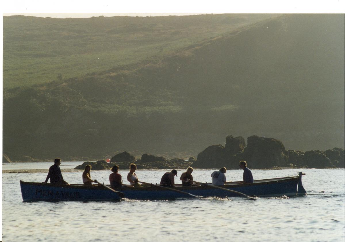 Gig boat girls rowing in New Grimsby Sound, Isles of Scilly