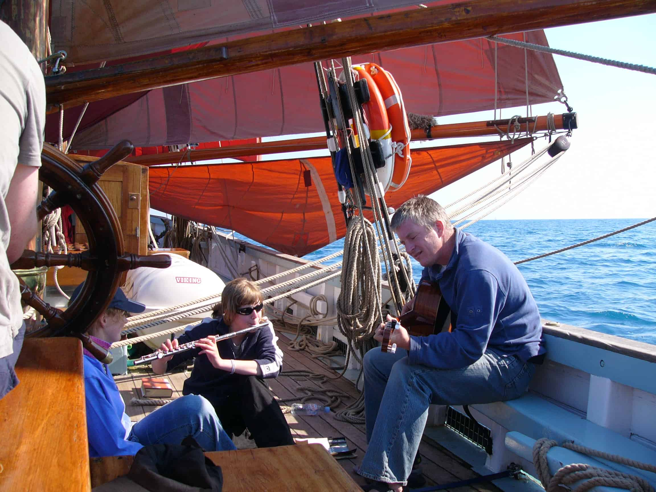 Musicians and a water sail on Provident