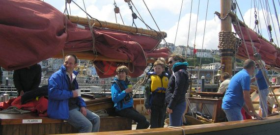family sailing with classic sailing