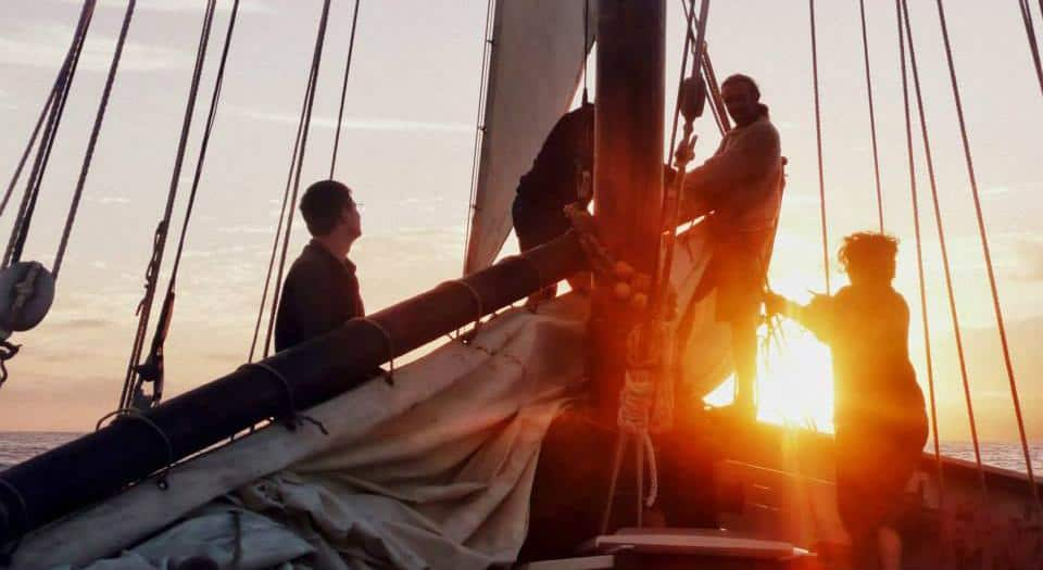 Lowering lug sails at the end of the day on Grayhound