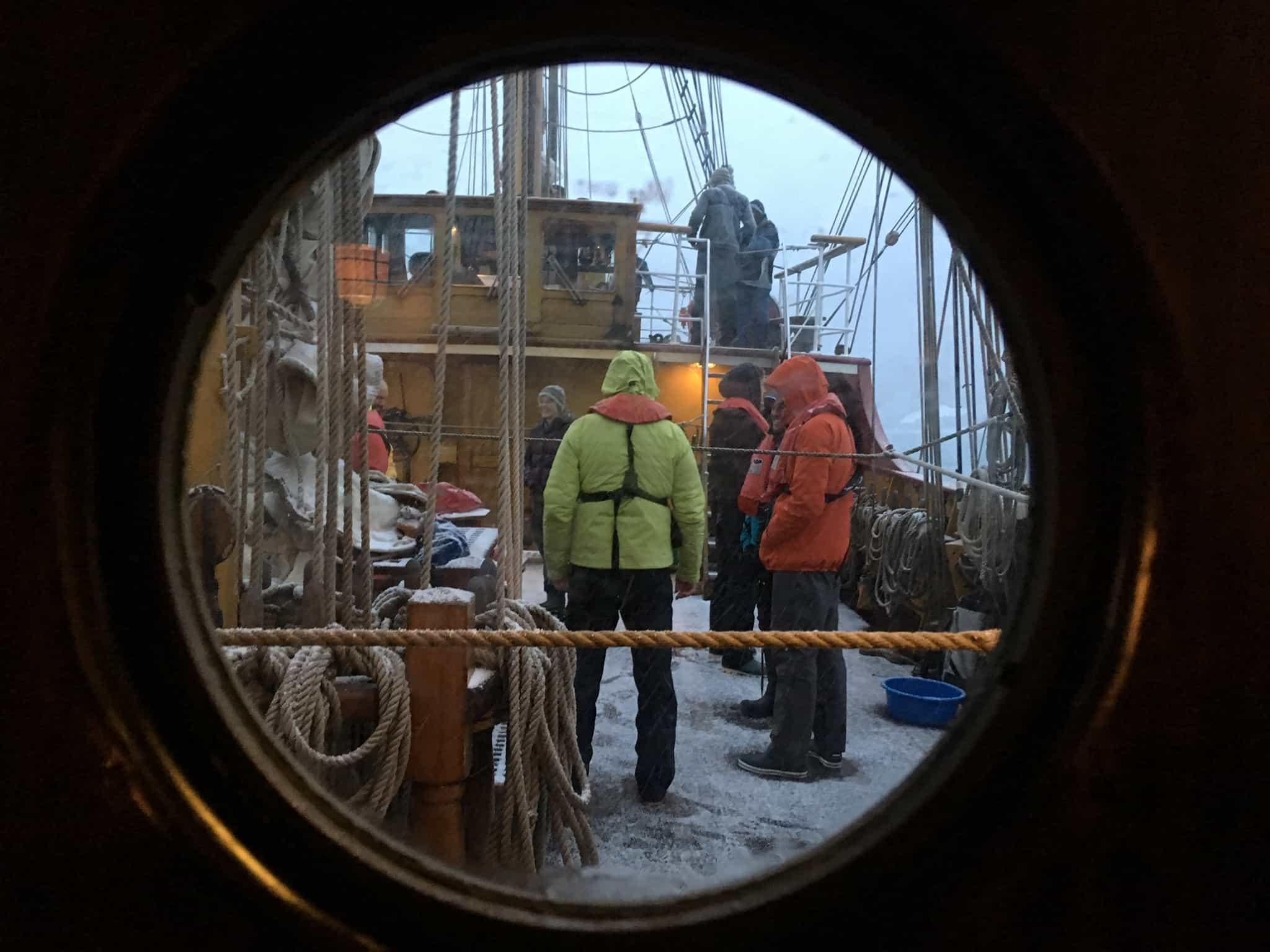 Bark Europa, view through the port hole in Antarctica