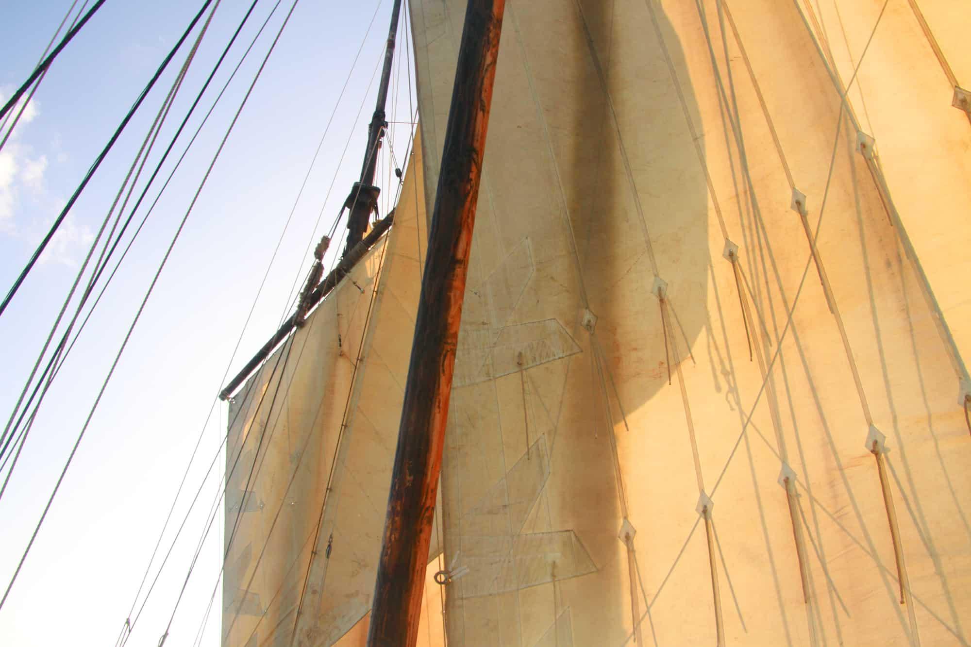 Lug sails on three masts power Grayhound across the Channel