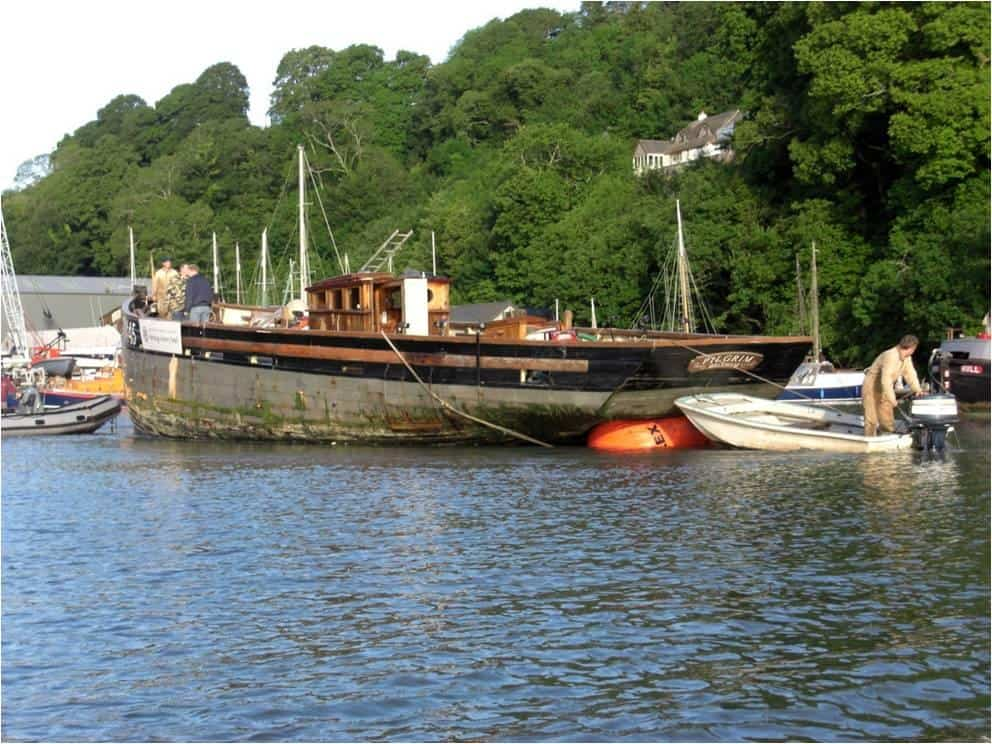 Pilgrim being towed to Ashley Butler's boat yard for restoration the River Dart.