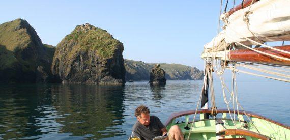 Luke reading onboard Agnes off the Cornish coast