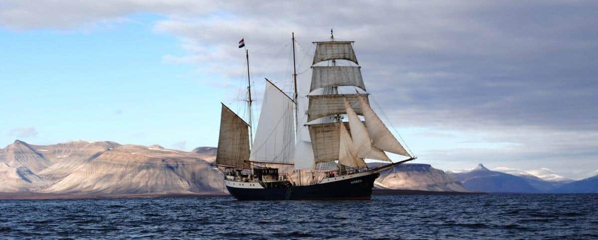 Antigua sailing the coast of Spitsbergen