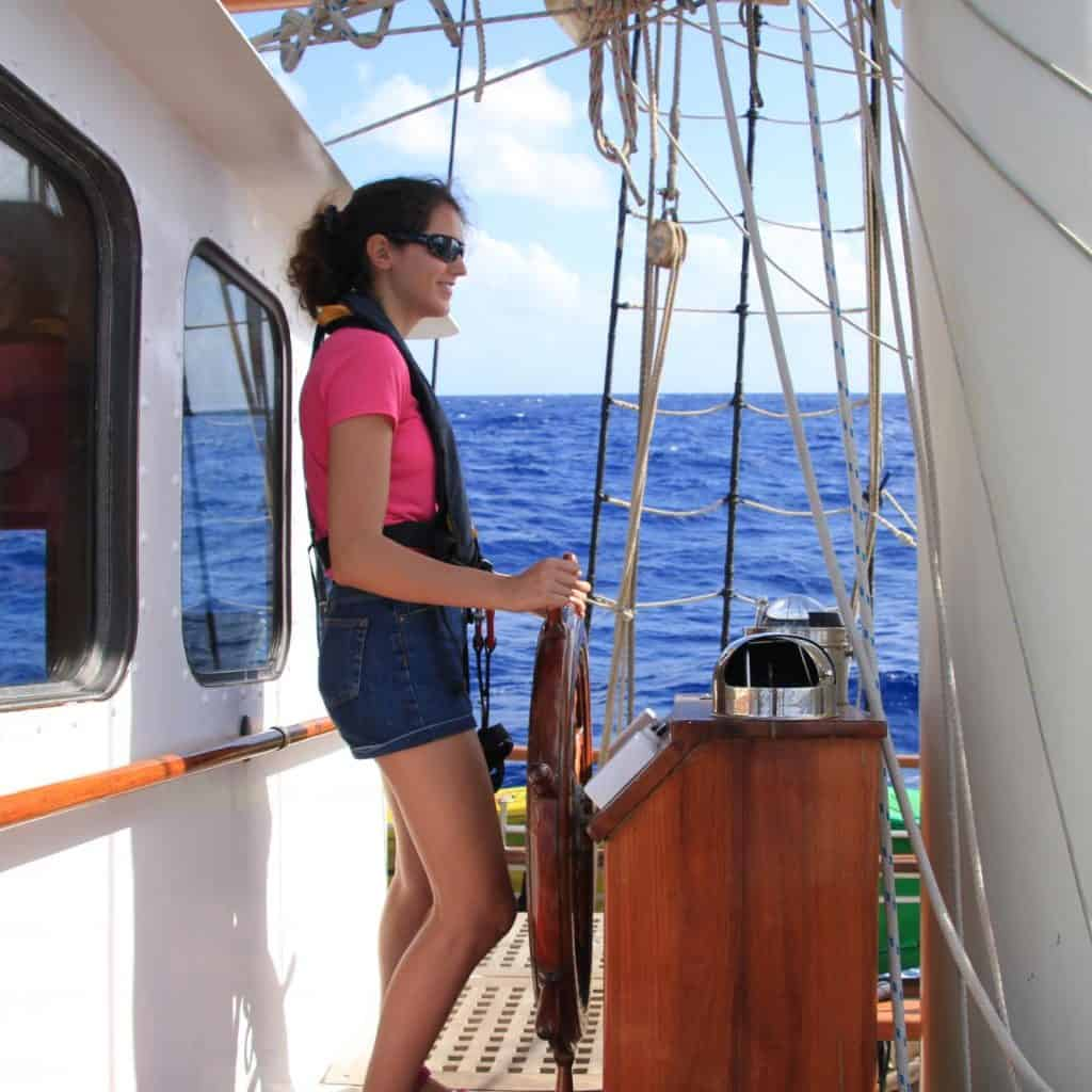 On the helm of Blue Clipper by Becky Prizeman