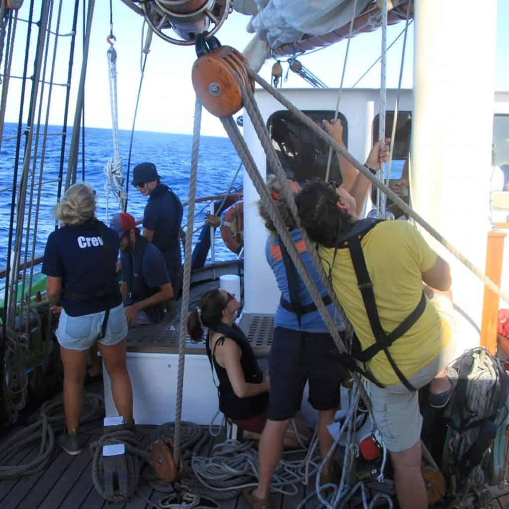 Raising the mizzen sail.