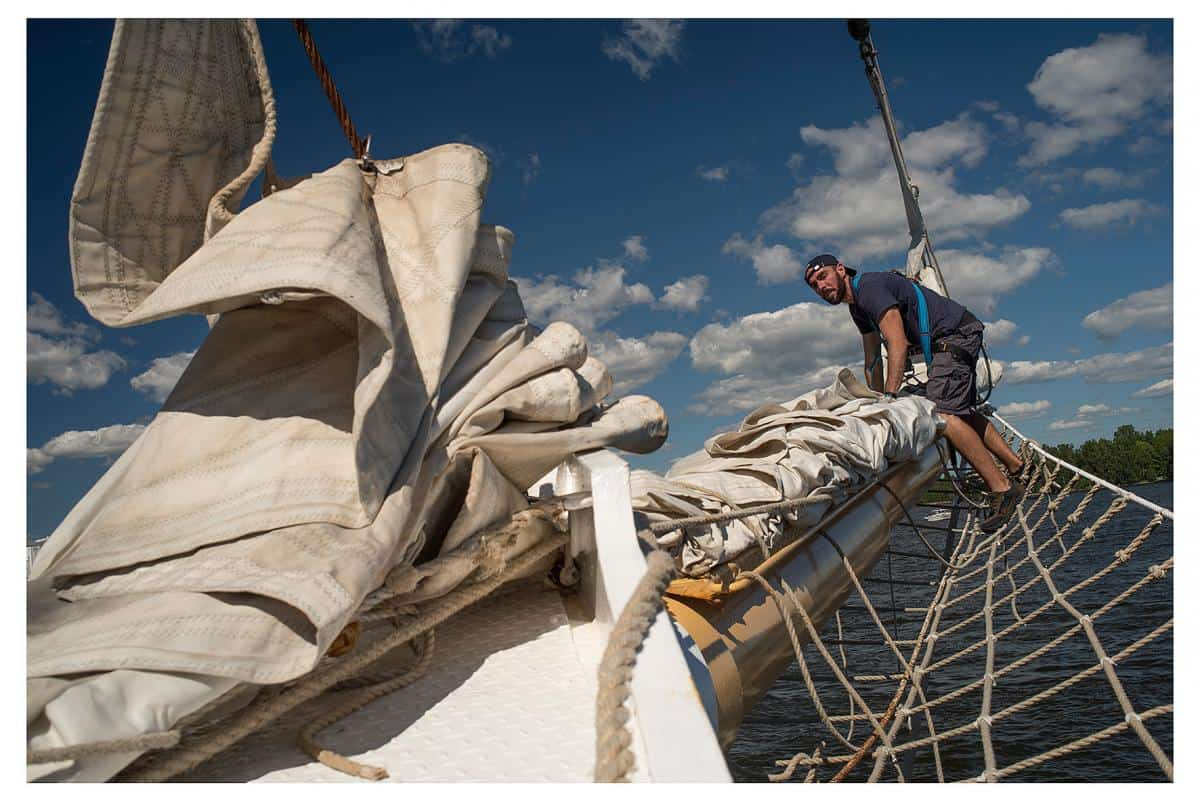 flaking the headsails on the bowsprit