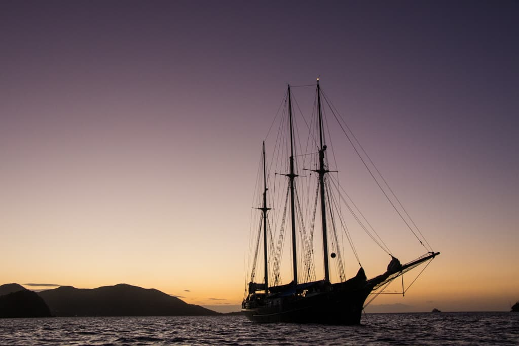 Blue Clipper in the sunset by Jan Broderick - Guest crew in the Caribbean
