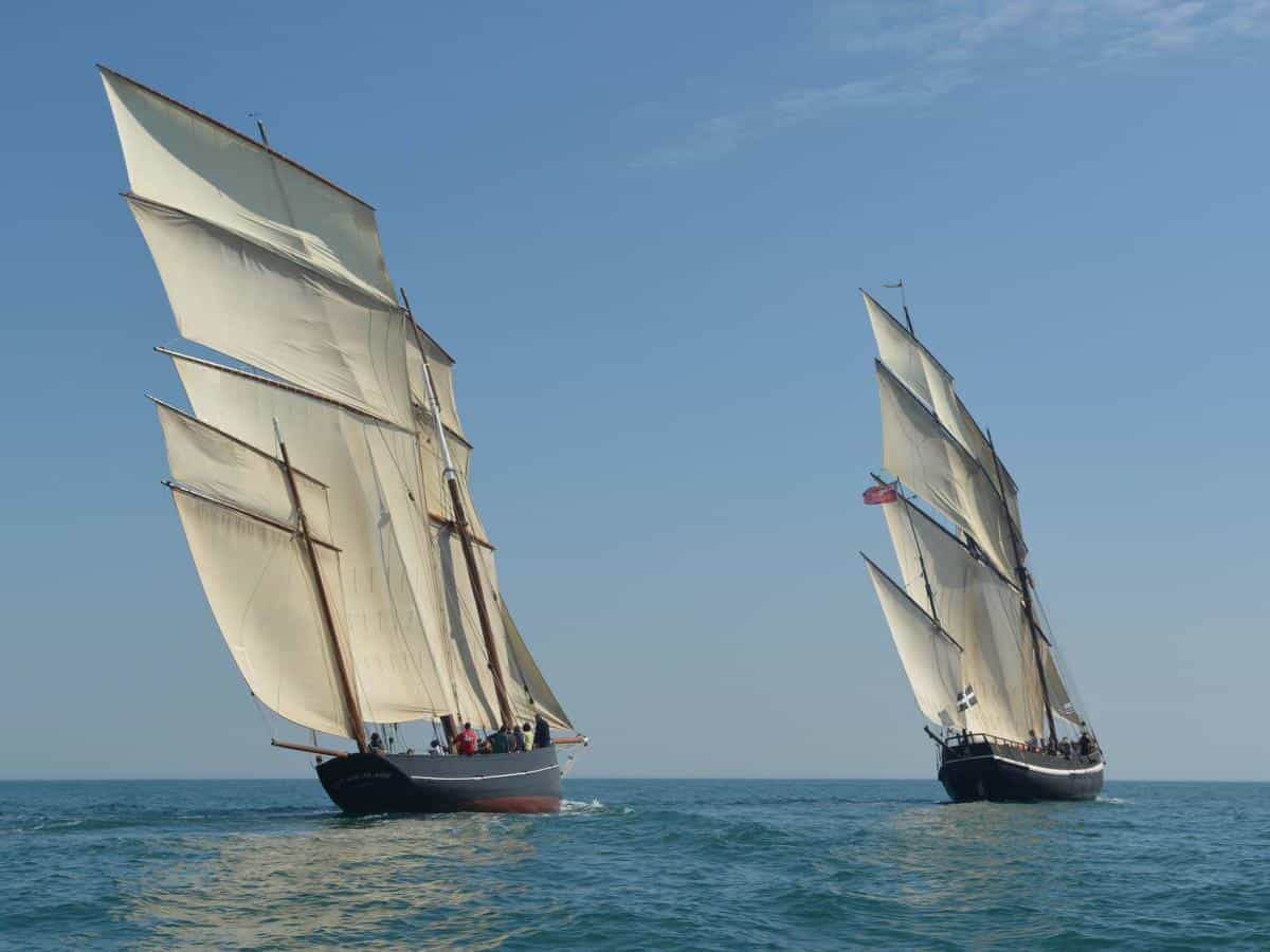 La Cancalaise and Grayhound racing.  Both ships are historic replicas.
