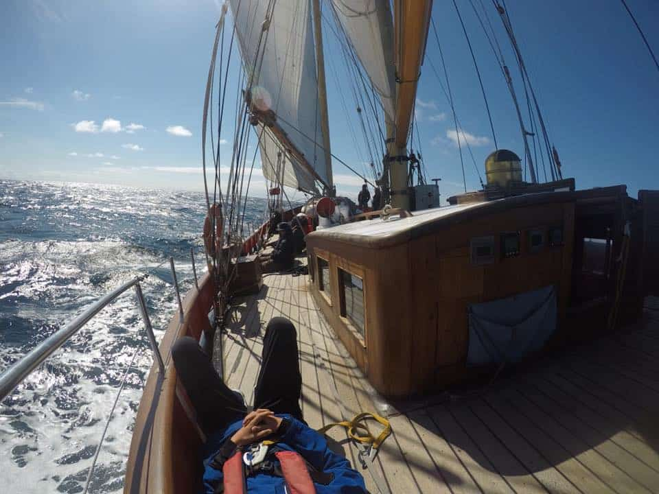 Maybe under sail, on deck