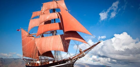 summer sailing under deep blue skies