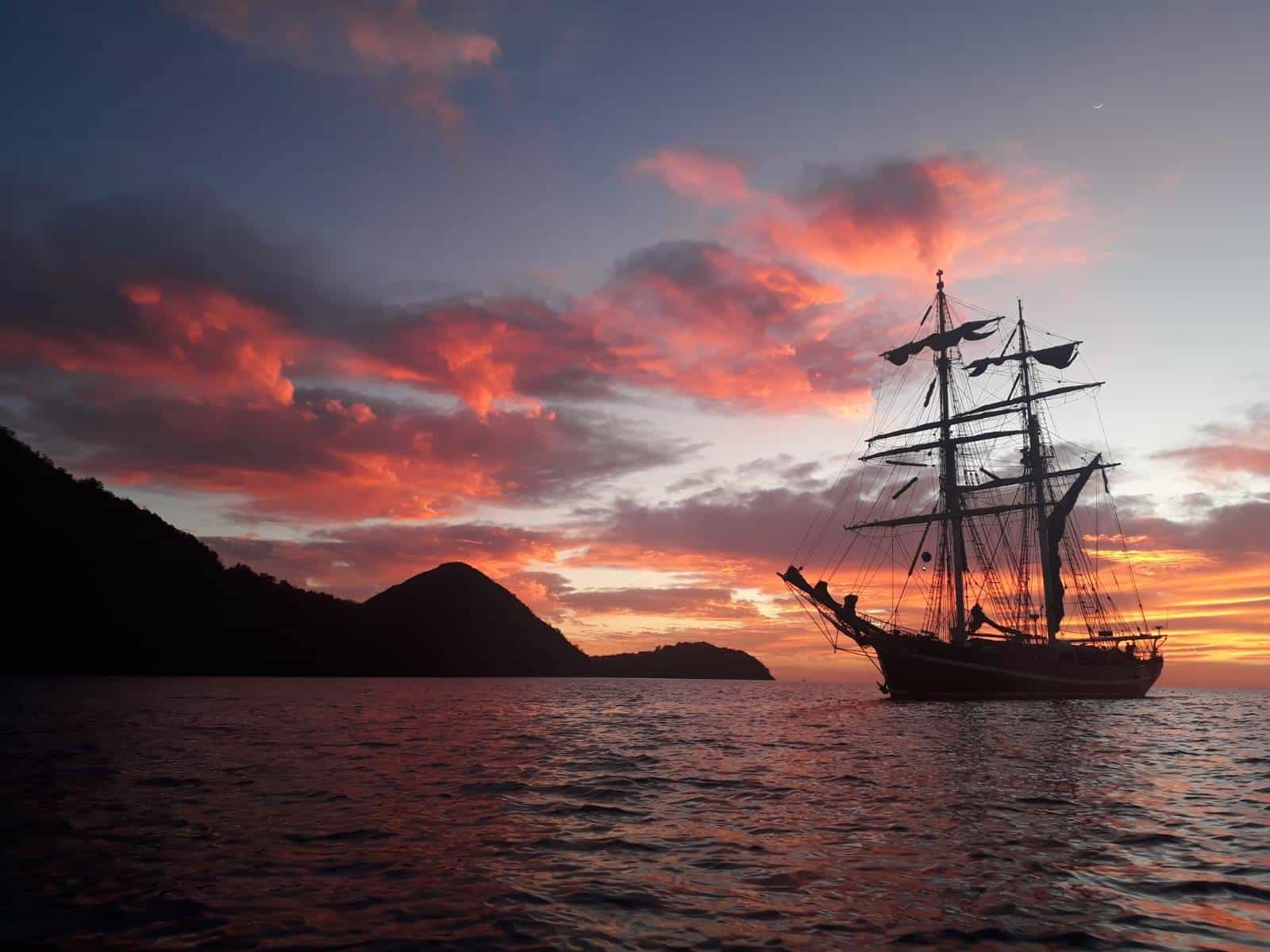Tall ship Eye of the Wind at Anchor for sunset in Guadeloupe
