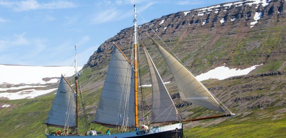 Tecla sailing the fjords in Iceland by Maria Cerrudo