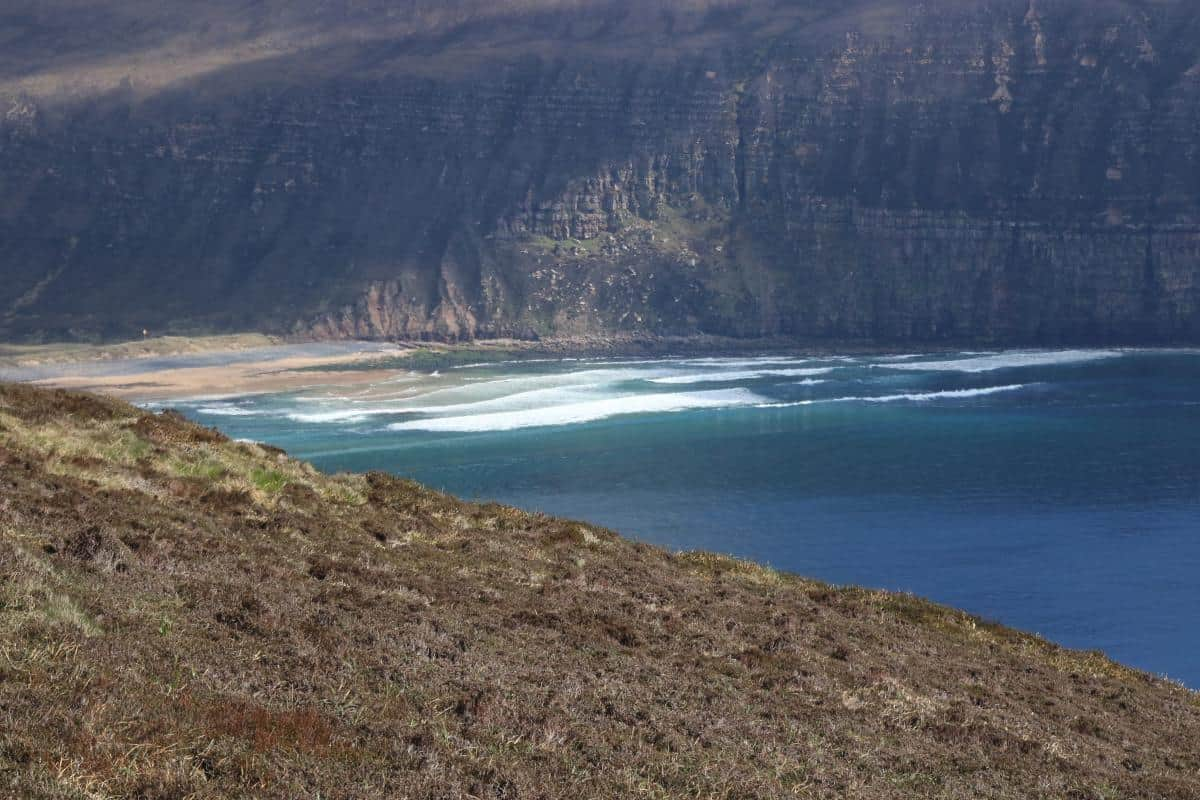 sandstone cliffs and surf breaks on Orkney