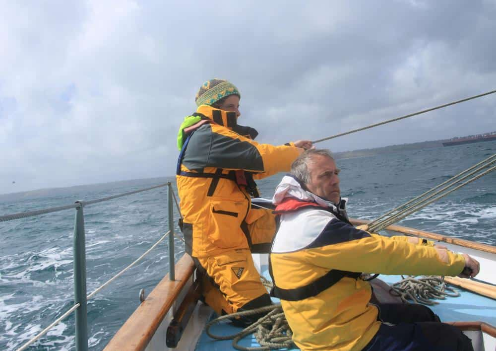preparing to gybe by pulling the mainsheet in