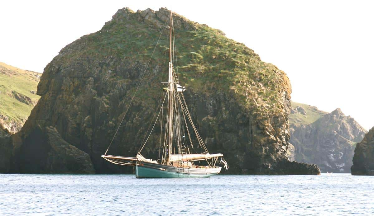 Agnes anchored off Mullion Cove on the Lizard