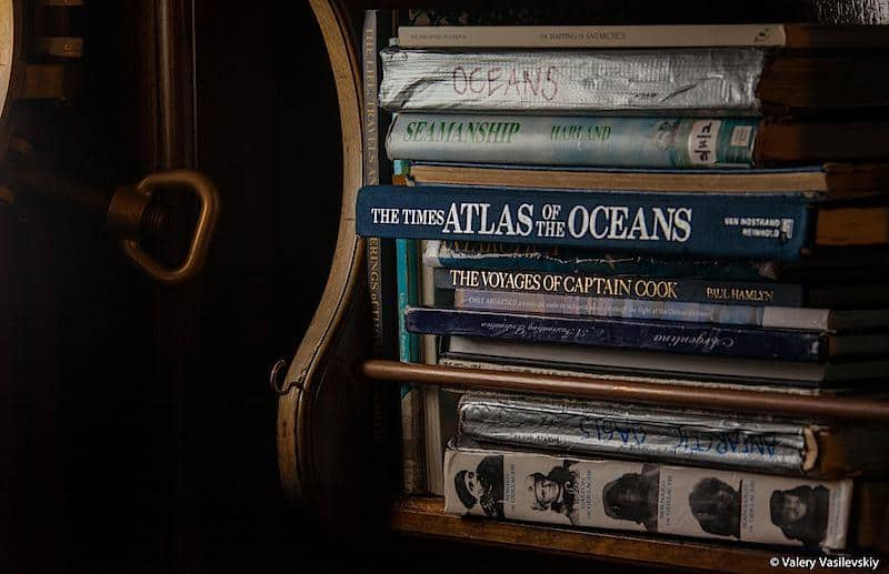 Library on Bark Europa with some well thumbed exploration and sailing books