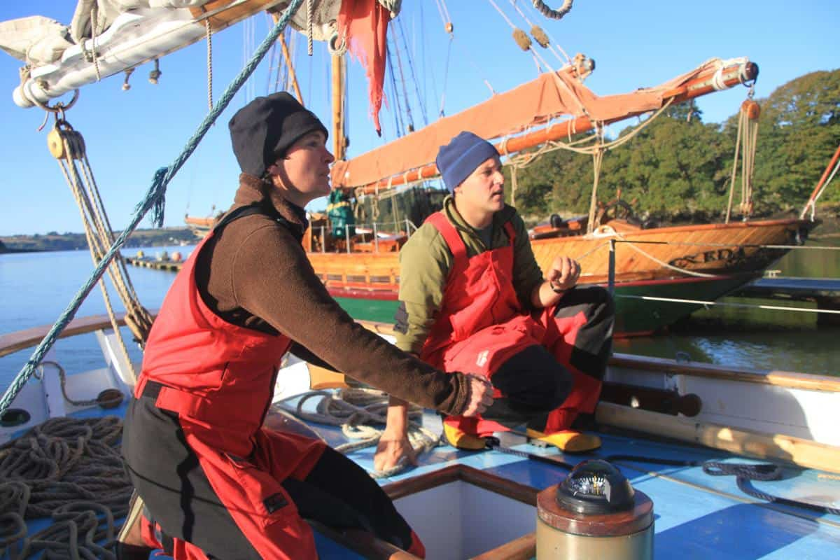 Learning to ferry glide a boat with a bowsprit into a narrow gap