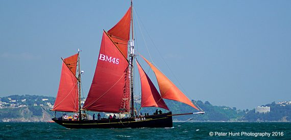 red sails in Torbay - Brixham Trawler Pilgrim by Peter Hunt