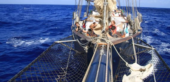 sail on blue clipper with classic sailing